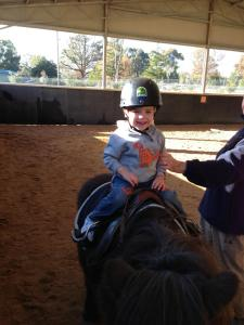 Darius participating in riding for the disabled